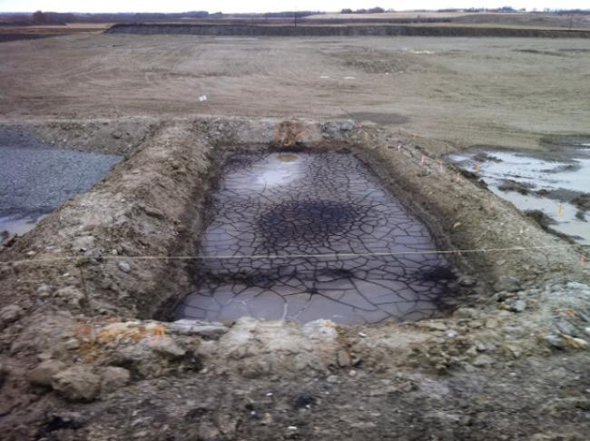 Diana Daunheimer found this large sump pit, or dugout designed to store drilling waste, at a wellsite northeast of her property in July 2012. Photo: Diana Daunheimer.