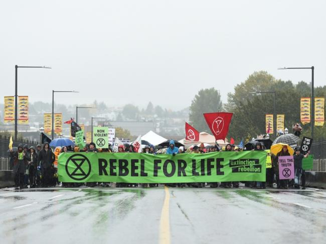 The protest group Extinction Rebellion closed the Burrard Bridge Monday morning to vehicle traffic and planned to be there all day. Photo Dan Toulgoet