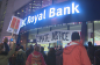 Protesters stand outside a Vancouver, B.C. bank on Dec. 1, 2016. (CBC)