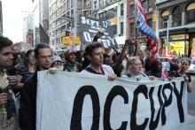 A parade of protesters makes its way down Broadway to New York City's Zuccotti Park in September 2012 to mark the one-year anniversary of Occupy Wall Street. Photo by Paul Stein / Flickr (CC BY-SA 2.0)