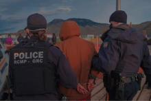 A photo posted to the Secwepemc Virtual Unity Camp Facebook page shows RCMP officers making an arrest last week near the drill site of the Trans Mountain pipeline expansion project. Facebook / Secwepemc Virtual Unity Camp