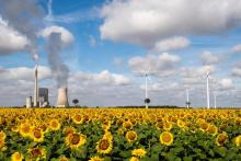 Coal and wind power in Mehrum, Germany, in August. Credit...Julian Stratenschulte/DPA, via Associated Press