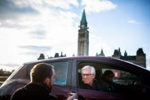 Natural Resources Minister Jim Carr listens to a question from Winnipeg Free Press reporter Dylan Robertson in Ottawa on April 8, 2018, in a Nissan Leaf driven by the minister's chief of staff, Zoe Caron. Photo by Alex Tétreault