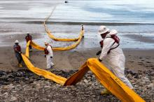 Workers prepare an oil containment boom at Refugio State Beach, north of Goleta, Calif., two days after a ruptured pipeline created the largest coastal oil spill in California in 25 years. AP
