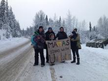 Wet'suwet'en women at the Gitdimt'en check point standing in solidarity with Unist'ot'en, Dec 2018. Photo from Wet'suwet'en Strong Facebook page.