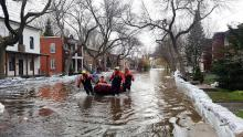 Flooding on Montreal's Rue Cousineau in May 2017. Direct impacts of climate breakdown, including extreme weather, could cost rich economies around the world twice as much as the COVID-19 pandemic already has. Photo by Cold, Indrid / Flickr (CC BY-SA 2.0)