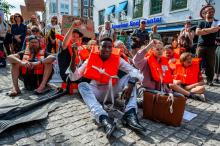 Hundreds gather in Amsterdam in solidarity with Carola Rackete, captain of the Sea-Watch 3 ship, who was arrested after a two-week standoff with Italian officials, in Amsterdam, July 4, 2019. ANA FERNANDEZ / SOPA IMAGES / LIGHTROCKET VIA GETTY IMAGES