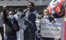 Wilner Cayo, centre, and Frantz Andre attend a demonstration outside Prime Minister Justin Trudeau's constituency office in Montreal, Saturday, May 23, 2020. THE CANADIAN PRESS/Graham Hughes