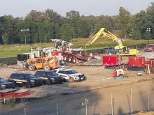 The drill site at Red Lake Treaty Camp at Thief River Falls in Minnesota. Four sheriff's deputies' cars are parked in front of the horizontal directional drill. Photo by Evelyn Austin