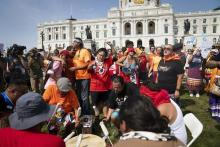 Water protector protesters dance and sing along to drumming during a protest against Line 3 and other pipeline projects at the State Capitol in St. Paul, Minn., on Wednesday. (Renee Jones Schneider/Star Tribune via AP)