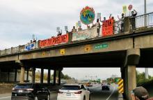 photos of TMX highway overpass banner drop in Burnaby