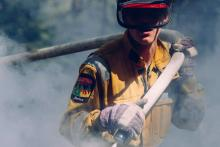 "Alberta firefighter in 2014. The Fort McMurray wildfire of 2016 was the ""largest single weather-related insurance loss event in Canadian history,"" a new report states. Alberta government photo"