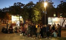 Neighbours gather while taking part in a neighborhood town hall meeting in Santiago earlier this month. Photograph: Pablo Sanhueza/Reuters