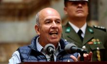 Arturo Murillo speaks to the media in La Paz. He says a recording shows the former president giving orders that would lead to citizens being starved. Photograph: Reuters