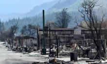 The charred remnants of homes and buildings in Lytton last month. Two people were killed in the Lytton blaze and most of the town destroyed. Photograph: Jennifer Gauthier/Reuters