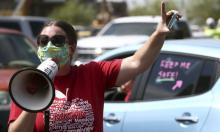 Teachers hold a '#Return2SchoolSafely' protest in Phoenix, Arizona, on 15 July. Photograph: Ross D Franklin/AP