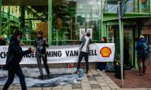 Climate activists protest against Shell in The Hague in October. Photograph: Ana Fernandez/SOPA Images/Rex/Shutterstock