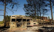 Burned buses at the Colorado Mountain Ranch in the historic town of Gold Hill in the Fourmile Canyon fire area in Boulder, Colorado, attest to the effects of a devastating wildfire, Photograph: Craig F Walker/Denver Post/Getty Images