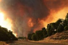 The 2018 Carr Fire in California, where climate change–driven wildfires have become a regular occurrence. (Eric Coulter / Bureau of Land Management via Flickr)