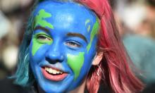 One of the youth climate strikers in Parliament Square. Photograph: Facundo Arrizabalaga/EPA