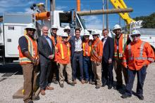 Prime Minister Justin Trudeau (centre) with B.C. Premier John Horgan and hydro workers at a training centre in Surrey, B.C. on Aug. 29, 2019. B.C. Government Photo