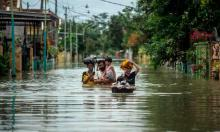 'In 2020 we saw deadly floods in Indonesia (above), bushfires in Australia, both drought and record rainfall in China and extreme storms from the Philippines to Nicaragua.' Photograph: Juni Kriswanto/AFP/Getty Images