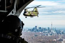 Members of 450 Tactical Helicopter Squadron fly over Toronto for Remembrance Day. Photo by aviator Lanny Jellicoe / Garrison Petawawa Imaging