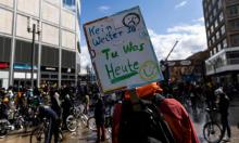 Environmental activists protest in Berlin in March. The report shows a significant increase in consumption of fossil fuels across building, industrial and transport sectors Photograph: Maja Hitij/Getty Images