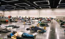 'People rest at the Oregon Convention Center cooling station in Oregon, Portland on June 28, 2021, as a heatwave moves over much of the United States' Photograph: Kathryn Elsesser/AFP/Getty Images