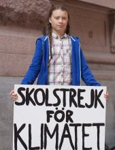 "In August 2018, outside the Swedish parliament building, Greta Thunberg started a school strike for the climate. Her sign reads, ""Skolstrejk för klimatet,"" meaning, ""school strike for climate"". Author : Anders Hellberg [CC BY-SA 4.0]"