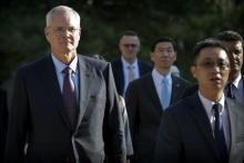 Exxon Mobil chairman and CEO Darren Woods arrives for a meeting with Chinese Premier Li Keqiang in Beijing in 2018.