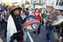 First Nations drummers on street after Northern Gateway decision