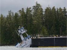 A tug and barge that carries petroleum products to and from Alaska through B.C.'s Inside Passage has run aground near Bella Bella. The Canadian Coast Guard confirms the Nathan E. Stewart, an articulated tug/barge owned by the Texas-based Kirby Corporation, ran aground at Edge Reef in Seaforth Channel just after 1 a.m. Thursday. The coast guard says the 287-foot long fuel barge was empty, but the 100-foot tug itself is leaking diesel fuel. People on the scene at noon said that the tug was half under water an