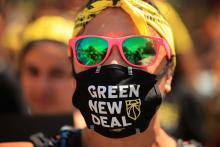 A young climate activist joins hundreds of fellow marchers as they walk to the White House to demand that U.S. President Joe Biden work to make the Green New Deal into law on June 28, 2021 in Washington, D.C. (Photo: Chip Somodevilla/Getty Images)