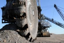 Photograph: Mining equipment called a bucketwheel reclaimer is used at oil sands mines in Alberta, Canada.