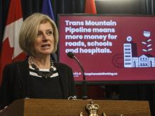 Alberta Premier Rachel Notley unveils an ad they will be running in B.C. about the pipeline expansion in Edmonton, Alta., on Thursday, May 10, 2018.	JASON FRANSON / THE CANADIAN PRESS