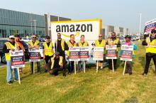 Members of Teamsters Locals 987 and 362 protest outside an Amazon fulfillment center in Alberta, Canada, on July 14, 2021, after meeting with Amazon workers across the country to discuss working conditions and union organizing. COURTESY: TEAMSTERS CANADA