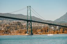 Lions Gate Bridge Vancouver BC - Government and its critics agree infrastructure needs to be built for a changing climate, but how it's financed will be pivotal to the type of infrastructure Canadians get. Photo by Andy Li / Unsplash