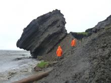 AWI PERMAFROST SCIENTISTS INVESTIGATE THE ERODING COASTLINE AT THE SIBERIAN ISLAND SOBO-SISE. CREDIT: ALFRED WEGENER INSTITUTE.