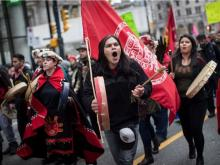 Alex Spence, centre, who is originally from Haida Gwaii, beats a drum and sings during a march in support of pipeline protesters in northwestern British Columbia, in Vancouver, on Tuesday.	DARRYL DYCK / THE CANADIAN PRESS