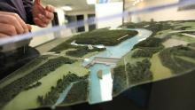 A model of the proposed Site C dam on the Peace River is seen at the Community Consultation Office in Fort St. John on Jan. 16, 2013. Roland Willson, chief of the West Moberly First Nations, asked the federal government to hit pause on BC Hydro's $9-billion hydro project to allow time for a review of the assessment process and to look for alternative energy sourc (Deborah Baic/The Globe and Mail)