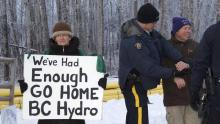 Penny Boden, left, and Arthur Hadland were two of three people arrested for blocking traffic and refusing to move at a Jan. 6 protest against the Site C dam outside Fort St. John, B.C. (Bronwyn Scott/Alaska Highway News)