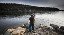 Gord Eby, a resident of Fort St. John, fishes on the Peace River in February. Treaty 8 First Nations argue that if the $8.8 billion dam goes ahead, it will have devastating impact on their ability to hunt, trap and fish.