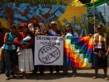 Bolivians rally in support of a Bolivian government law passed last year that grants rights to Mother Earth.