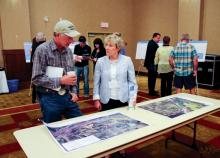 Ken Boon (left) attends a Site C open house in Fort St. John on July 9, 2015, at the Pomeroy Hotel. Photo By WILLIAM STODALKA