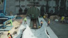 This photo shows workers creating a tunnel.Trans Mountain