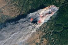 The wildfire that wiped out Paradise, California, viewed from space. At last count, there were 88 confirmed dead, 296 missing, The fire destroyed 13,972 homes, 528 commercial buildings and 4,293 other structures. (NASA)