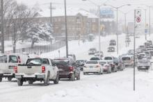 Drivers cope with hazardous conditions during the 2014 polar vortex.  Elena Elisseeva / Shutterstock.com
