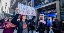 Protesters picket outside a Chase Bank branch in November 2019. (Photo: Erik McGregor/LightRocket via Getty Images)