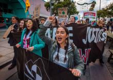 Students and their supporters protest as they demand transformative climate change action during the Black Friday sales in Santa Monica, California, on November 29, 2019.